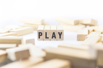 Alphabet letters on wooden pieces collected to word play with cl