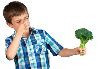 Boy Looking at Broccoli with Disgust
