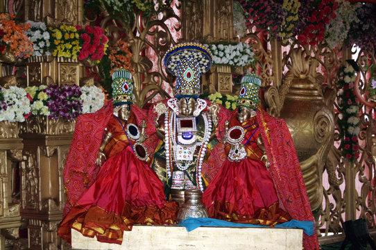 Closeup photo of idols of Indian Hindu God balaji or venkatewara with consorts