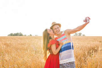 Young couple take photo by mobile phone