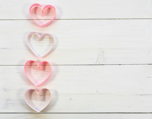 Vertical row of paper hearts