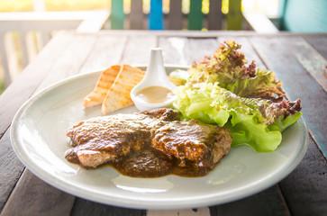 Steak beef tenderloin on wooden table for lunch.