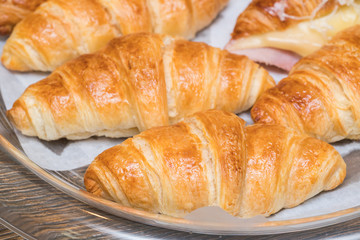 fresh croissants on wooden table