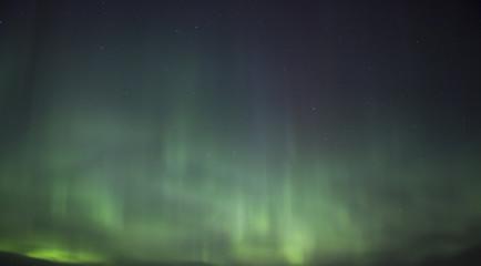 Northern lights illuminating the sky. Magical moment in Finland. Aurora borealis is beautiful phenomenon