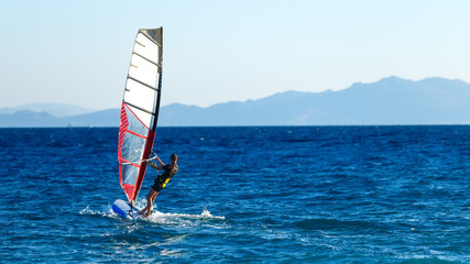 windsurfer in background of mountains in the distance. summer Sunny day. Greece, Rhodes