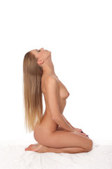 Attractive adult girl with a naked body sitting over white background