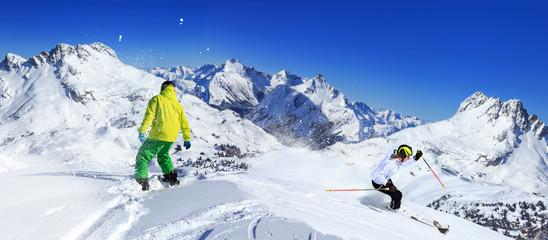 snowboarder and ski driver