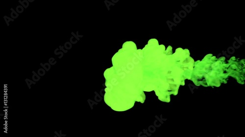 stylized green ink drop in water on a black background  3d