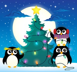 Penguins around Christmas tree theme 3
