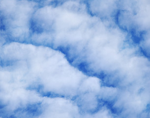 White clouds on blue background