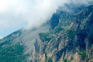 The wild and desolate mountains with clouds of the Baikal Lake
