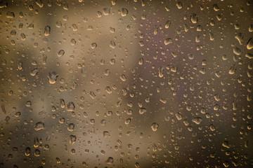 very wet window full of raindrops during rainny.