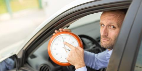 Businessman late stuck in traffic