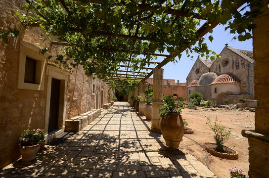 Arkadi monastery on Crete island, Greece. Ekklisia Timios Stavros - Moni Arkadiou in Greek. It is a Venetian baroque church. Details of the yard and the buildings outside the church.
