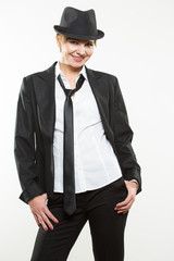 Beautiful young woman posing in business suit and hat.