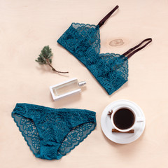 Shopping and fashion concept. Set of glamorous stylish sexy lace lingerie with morning coffee, woman accessories on wooden background.