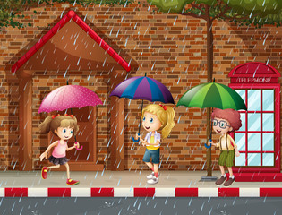 Three kids in the rain