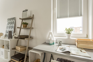Grey desk and wooden shelf in the living room