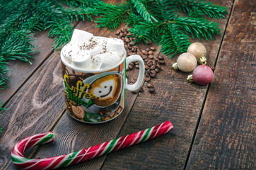 Coffee with marshmallow on christmas background