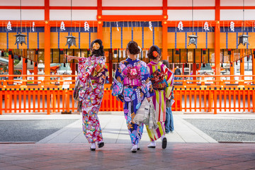 Women in traditional japanese kimonos on the street of Kyoto, Japan.