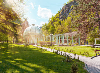 Borjomi Central Historical Park. Georgia. Source with healing mineral water. Beautiful pavilion with a glass dome. Wall mural