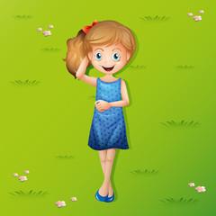 Happy girl lying on grass