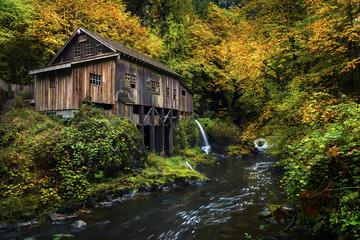 Cedar Creek Grist Mill with fall color. Located in Woodlands, Washington.