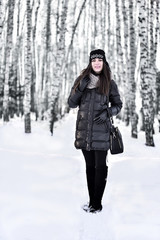 Girl with dark long hair in the winter park