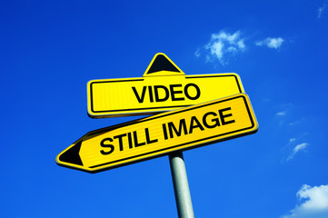 Video vs Still Image - Traffic sign with two options - using camcorders and shoot films, clips and motion picture vs using cameras and take photos and photographs