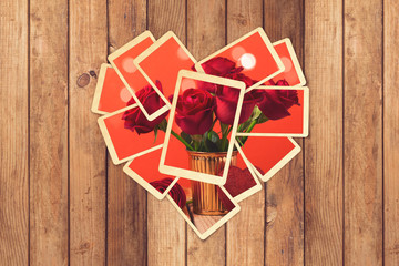 Retro instant photos in heart shape with romantic image on wooden table for photo album design. Valentine's day concept