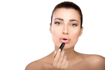 Beauty model applying lipstick to her lips