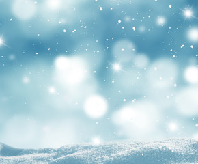 Winter background with snow and blurred bokeh.
