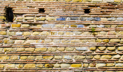 Wall made of stone or brick in the archaeological ruins of the ancient Roman town Velia, Campania. Italy