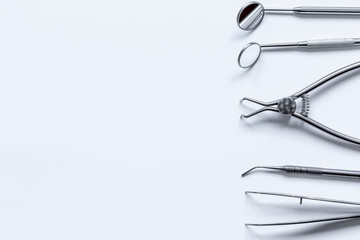 dental tools on white background top view