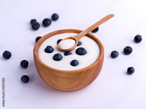 Blueberries Wooden Bowl On White Background Stock Photo