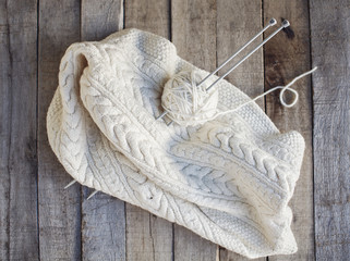 Beautiful cozy knitted and ball of wool with needles