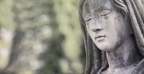 Statue of Virgin Mary in tears (sadness, regret, fear, faith, re