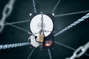 Chained hard disc drive with combination padlock. Conception of data protect