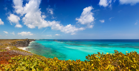 Panoramic view of the cliffs, reef and turquoise shallows at Mudjin Harbor, Middle Caicos