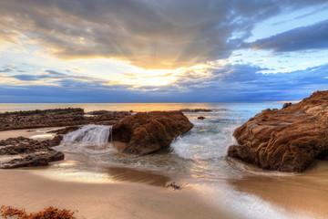 Wall Murals Bestsellers Sunset over the rocks at Pearl Street Beach in Laguna Beach, California, USA