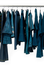 female blue dress and trousers, coat  isolated on hanging
