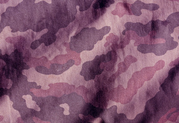 Camouflage color cloth surface.