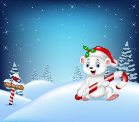 Cartoon Christmas background with polar bear holding candy