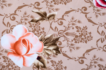 Texture, background. Fabric cotton bed linen. brown with flower