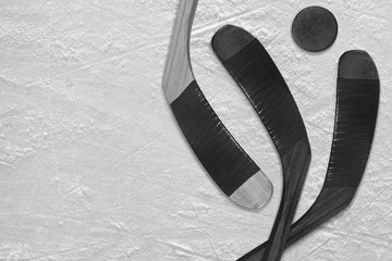 Hockey puck and stick on the ice three