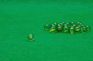 Marbles displayed on a green background