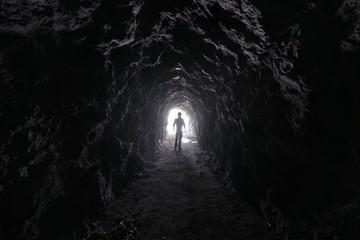 Man explores a cave