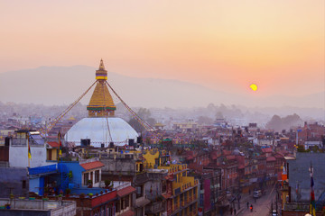 Fotorollo Nepal Kathmandu city view on the early morning on sunrise with rising sun and famous buddhist Boudhanath Stupa temple. Tibetan traditional architecture, Nepal.