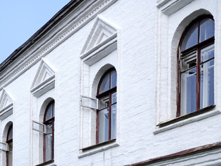 Windows on the white wall of the house
