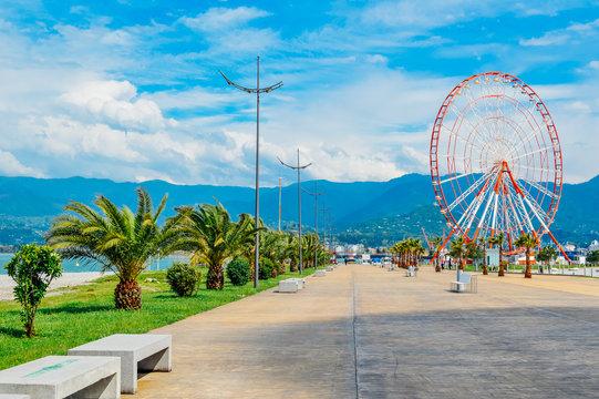 Seafront Promenade on Black Sea coast with ferris wheel view in Batumi, Adjara, Georgia